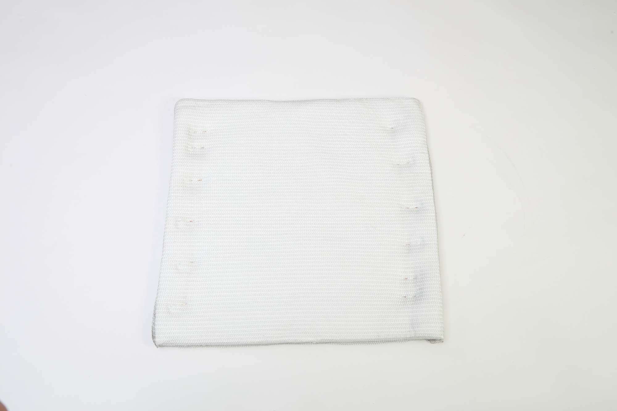 Image of Ceramic fibre insulation blanket 96kg/m³ in stainless steel mesh 25x600x600mm.